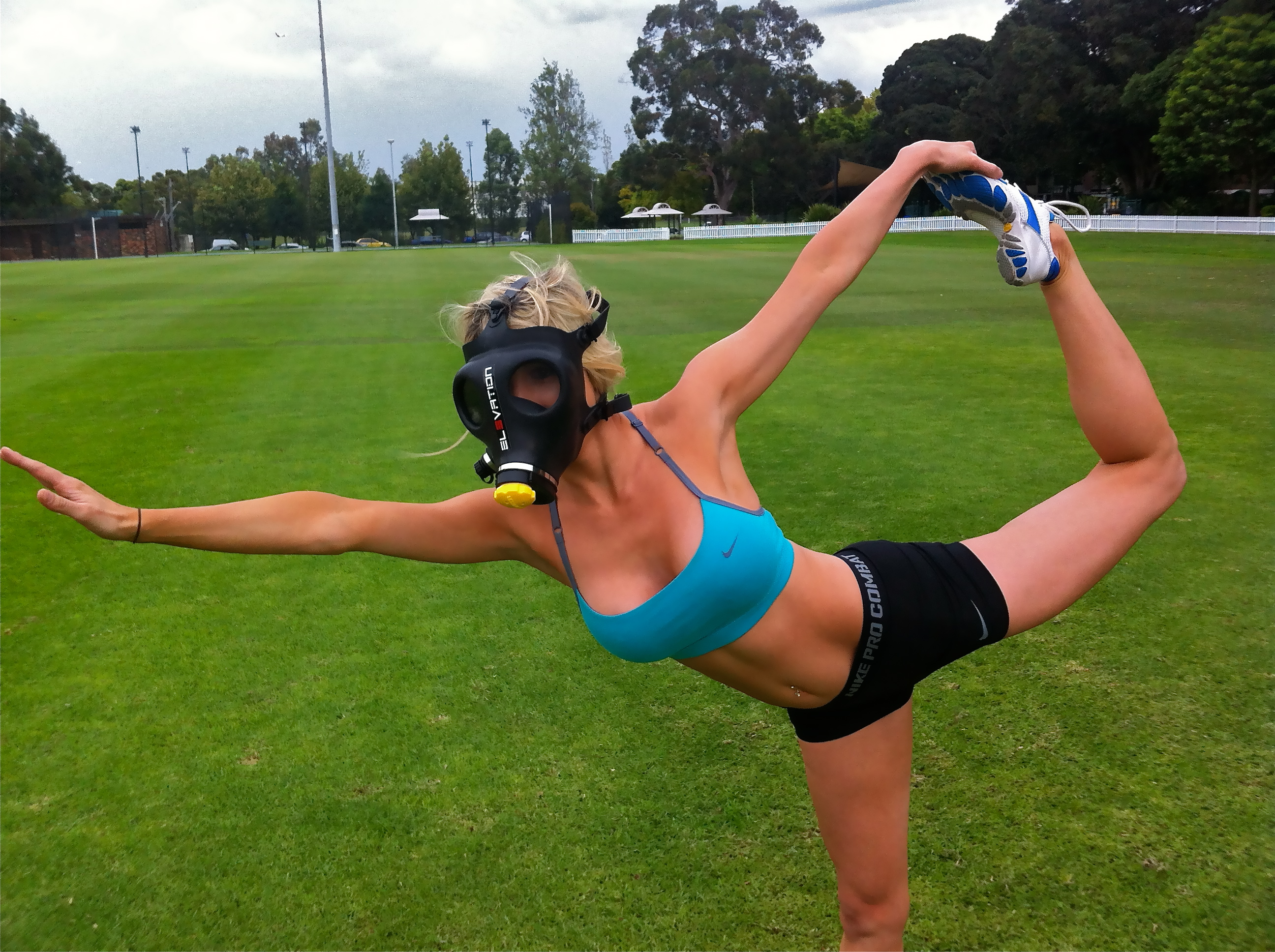 Emma doing yoga in Elevation Training Mask
